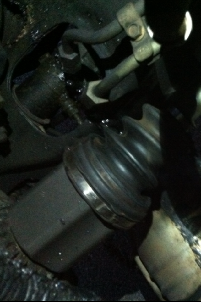 Passenger side grease leak, Axle recently replaced-photo.png