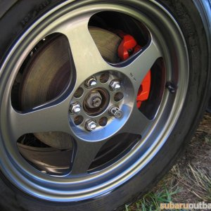 Detail of red painted calipers.