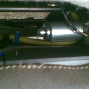 Amplifier under passenger seat